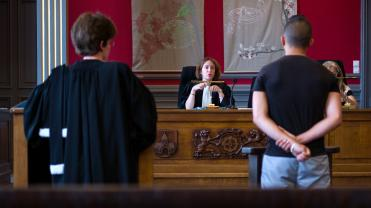 A judge speaks to a youth during a hearing at the children's court in Mulhouse on June 26, 2013. AFP PHOTO / SEBASTIEN BOZON